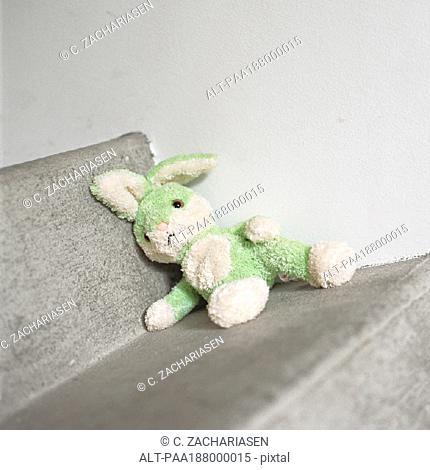 Stuffed rabbit sitting on step