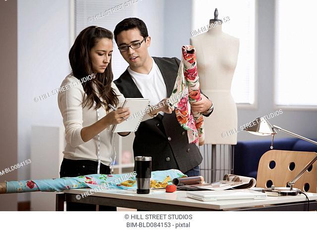 Clothing designers working in workshop together