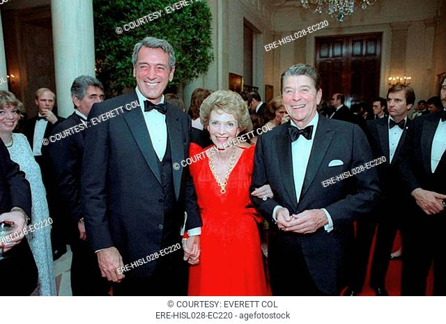 President Reagan and Nancy Reagan with Rock Hudson at state dinner for President De La Madrid of Mexico. May 15 1984