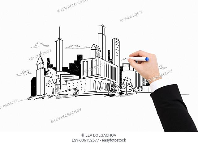 business and architecture concept - close up of businessman drawing city sketch