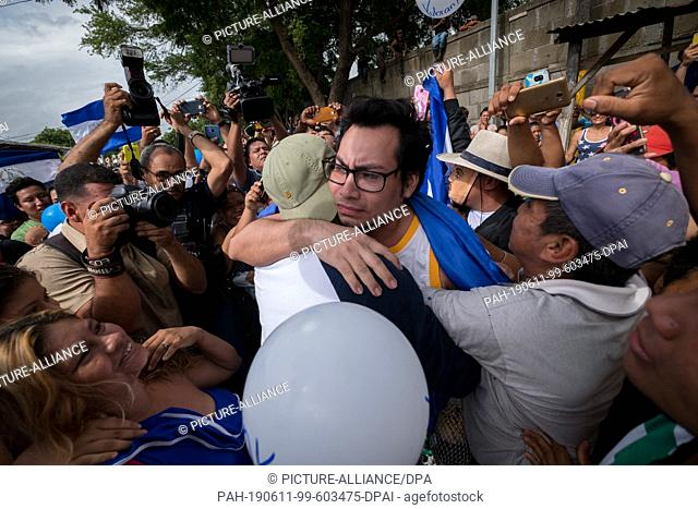 11 June 2019, Nicaragua, Managua: Yubrank Suazo (M.), a prominent figure in the student protests against the government, embraces a friend as he is awaited by...