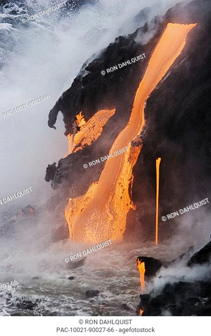 Hawaii, Big Island, near Kalapana, Pahoehoe lava flowing from Kilauea into Pacific Ocean, Steam rising