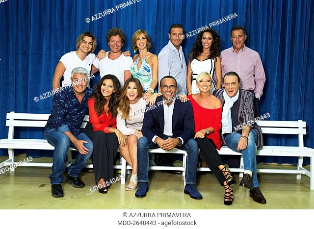 The full cast posing during a photo shoot realized inside the television studio where the talent show 'Tale e quale show' is recorded: standing