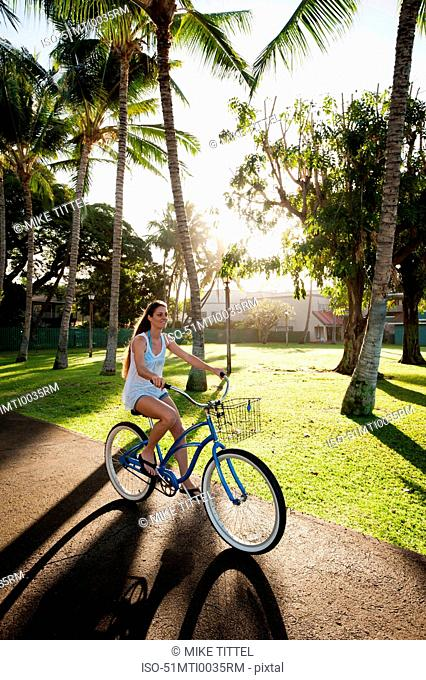 Woman riding bicycle in park