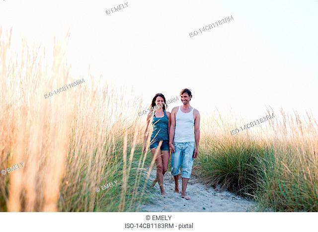 couple strolling along beach