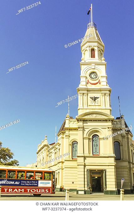 Fremantle, Western Australia - 2011: A tourist tram passing by Fremantle Town Hall