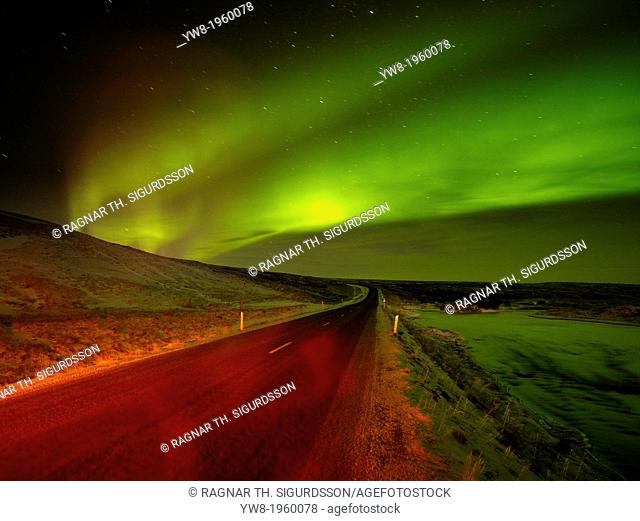 Aurora Borealis over empty road, Iceland