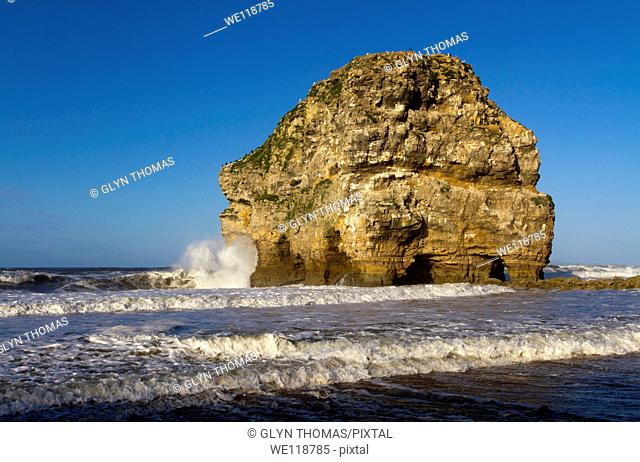 Marsden Rock, a rock formation in the North Sea at Marsden Bay, South Shields, Tyne and Wear, England, UK