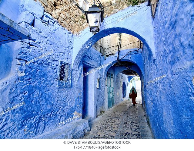 street scene in the atmospheric blue town of Chefchaouen, Morocco