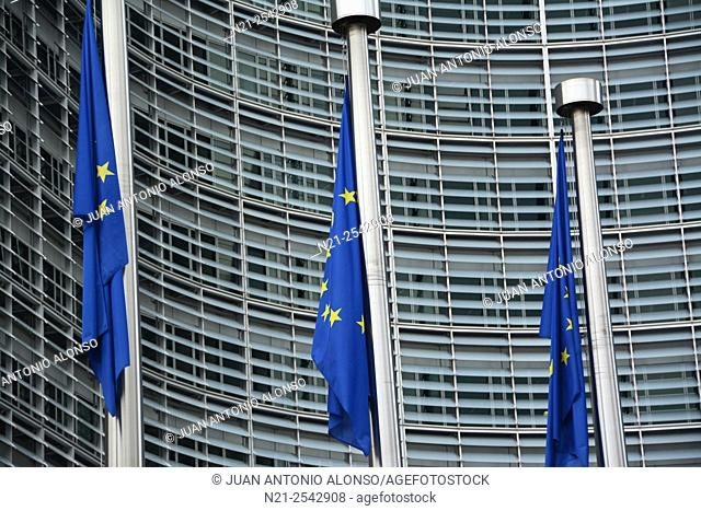 European flags in front of the European Commission Headquarters -Berlaymont Building-. Brussels, Belgium, Europe