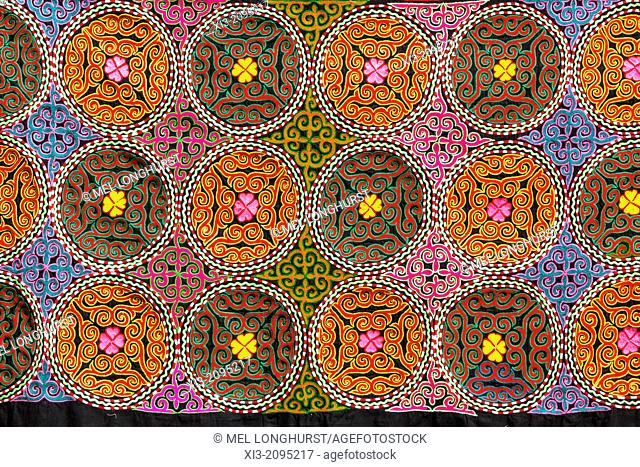 Colourful Suzani textile, cotton hand embroidered needlework, for sale, Bukhara, Uzbekistan