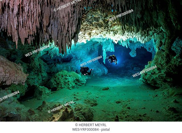 Mexico, Yucatan, Tulum, two cave divers exploring the cave system of Cenote Chan Hol