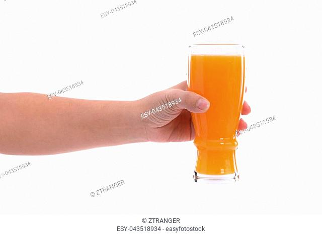Close up glass of orange juice in hand on white background isolated