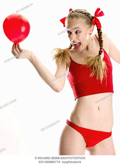 woman wearing lignerie with a balloon