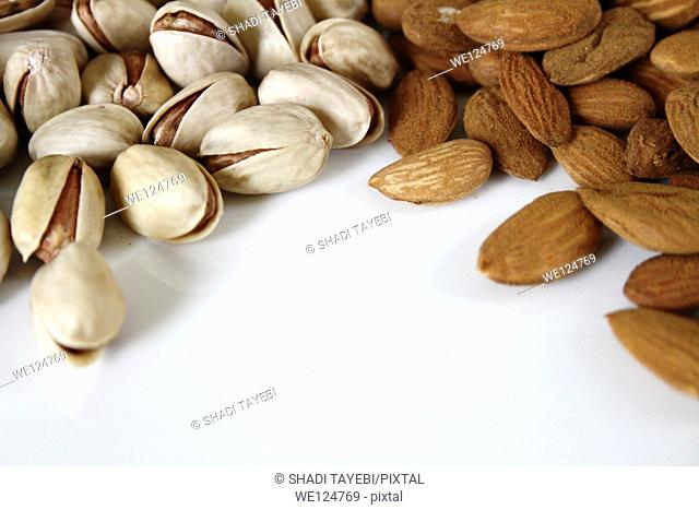 Almonds and walnuts isolated on the white background