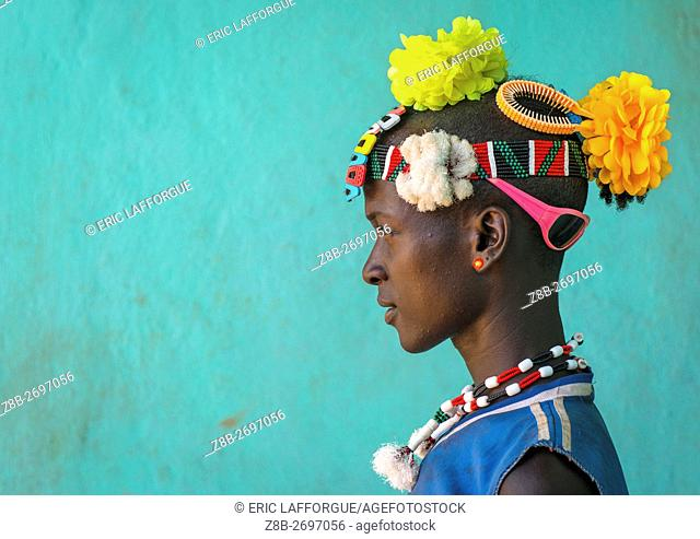Ethiopia, Omo Valley, Key Afer, profile of a bana tribe man with plastic flowers in the hair