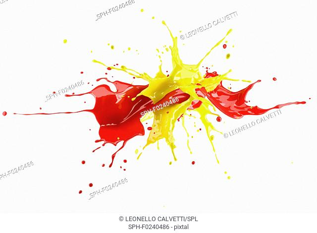 Red and yellow paint splash explosion, splashing against each other. Isolated on white background