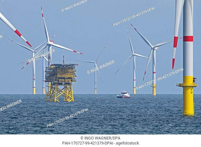 """The offshore wind park """"""""Nordsee 1"""""""" can be seen in front of the East Frisian island Spiekeroog, Germany, 27 July 2017. At this moment roughly half of the 54..."""