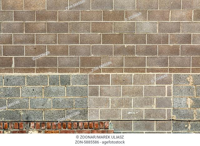 brickwork background texture with different shapes and colors of bricks