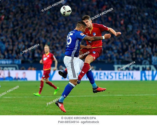 Hoffenheim's Pirmin Schwegler (r) and Schalke's Dennis Aogo vie for the ball during the German Bundesliga soccer match between FC Schalke 04 and TSG 1899...
