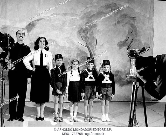 Italian actor and scenarist Galeazzo Benti (Galeazzo Bentivoglio) and Italian actress Silvana Pampanini posing wearing a fascist uniform in the segment...