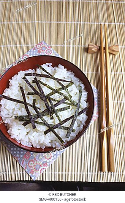 Japan, bowl of Japanese rice in table setting