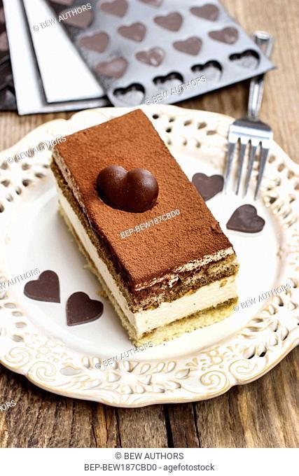 Tiramisu cake decorated with homemade chocolate hearts