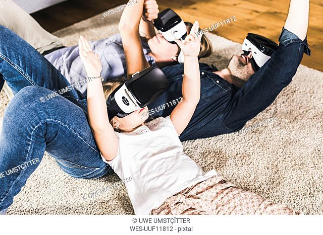 Family using VR goggles at home