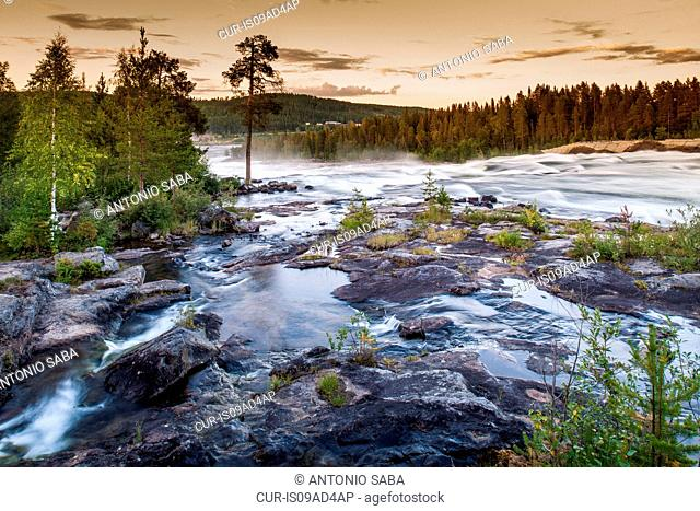 View of river flowing over rocks, Storforsen, Lapland, Sweden