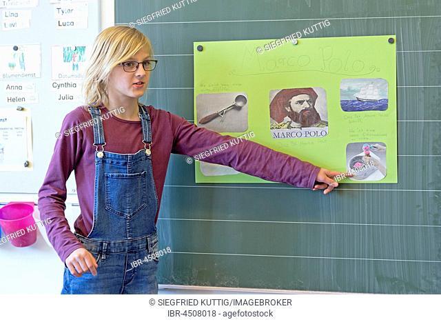 Schoolgirl at the blackboard, giving a presentation, Primary School Lower Saxony, Germany