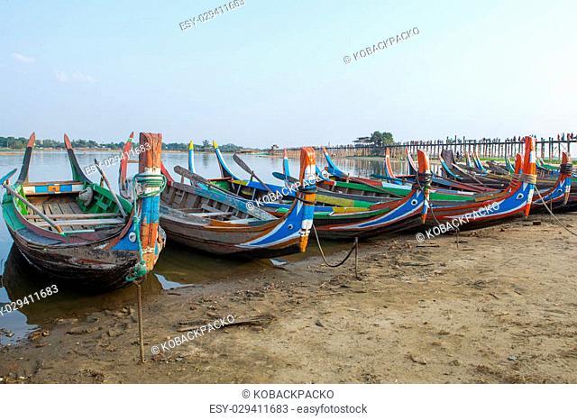 Tradition of local boat on Amarapura lake with U-Beig bridge background