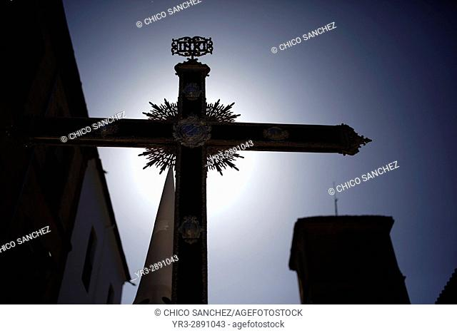 Silhouette of a penitent holding a cross during Easter Week celebrations in Baeza, Jaen Province, Andalusia, Spain