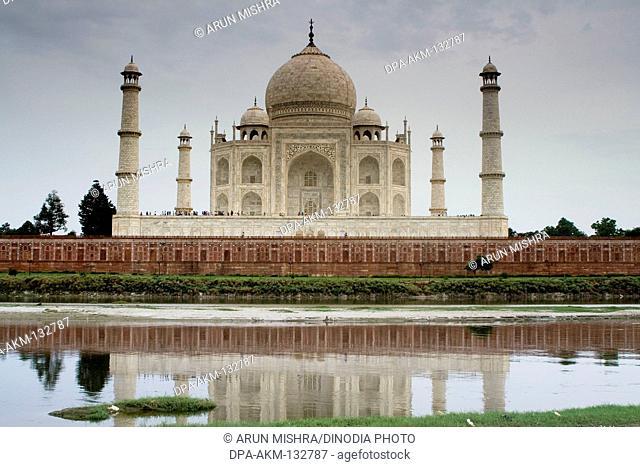 Mughal monument taj mahal on Yamuna river ; Agra ; Uttar Pradesh ; India