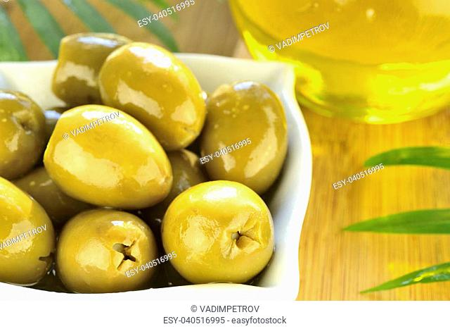 Stuffed green olives and olive oil macro (horizontal)