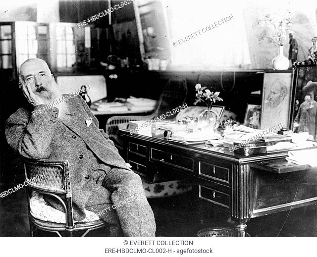 CLAUDE MONET-The painter in his study in Giverny, France. - CPL Archives/Everett Collection