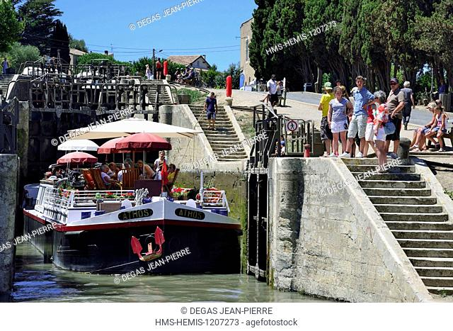 France, Herault, Beziers, Canal du Midi listed as World Heritage by UNESCO, locks of Fonseranes, barge at the exit of the lower airllock side downstream