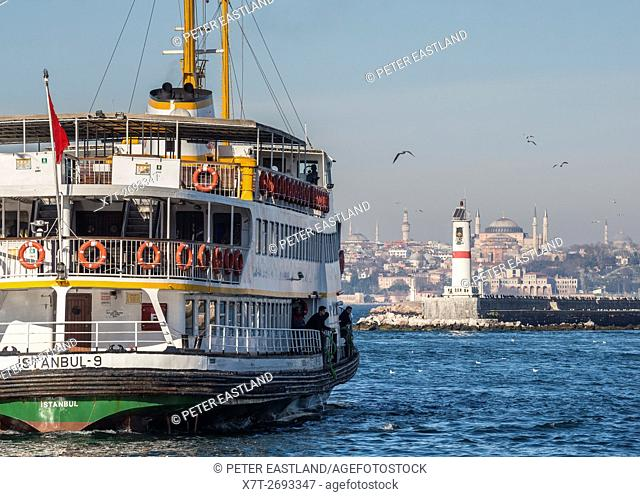 A passenger ferry leaving Kadikoy on the Asian side of the city with the Istanbul skyline in the background, Turkey