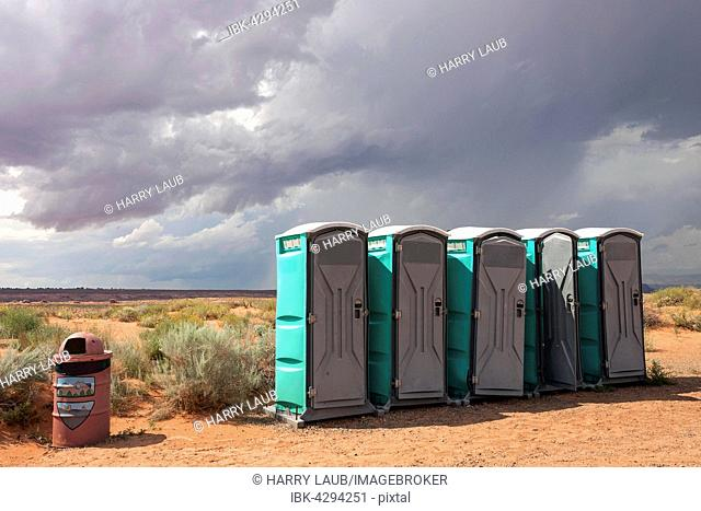 Toilets cubicles in steppe landscape, Lake Powell, Page, Arizona, USA