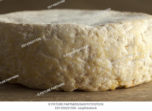 Reblochon de Savoie cheese from raw cows milk close up