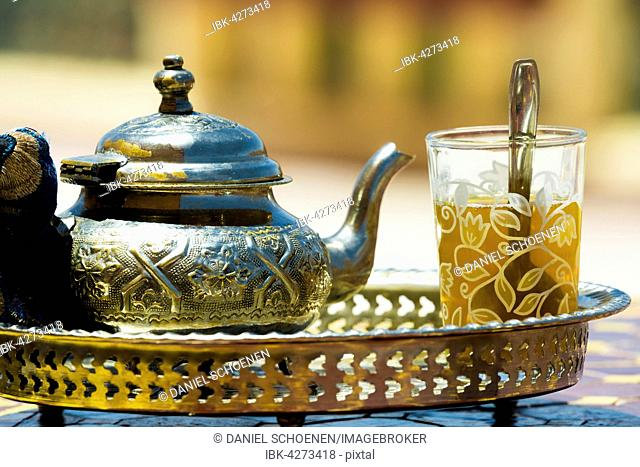 Glass with mint tea and silver teapot, Morocco