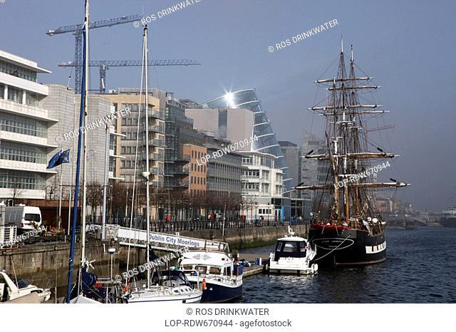 Republic of Ireland, Dublin, Dublin, Boats and a tall ship at Dublin City Moorings on the River Liffey in the North Wall area