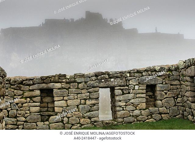 Archaeological site of Machu Picchu, Cusco, Peru. Intihuatana seen from the Acllawasi