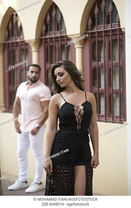 Man looking at a sexy woman in the street