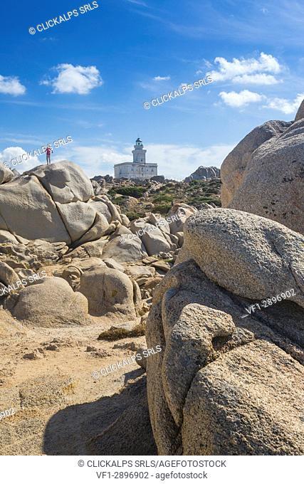 Child on the granitic rocks admires the lighthouse Capo Testa Santa Teresa di Gallura Province of Sassari Sardinia Italy Europe