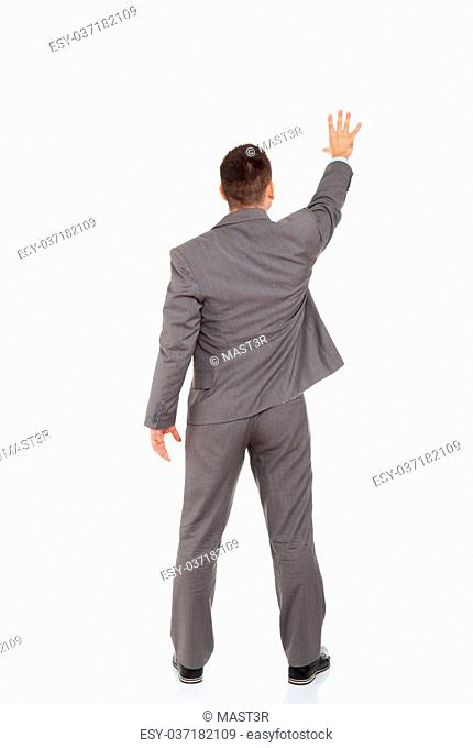 Rear view of business man pointing palm at copy space isolated over white background, full length portrait of businessman standing back