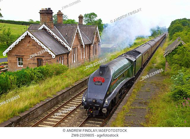 LNER Class A4 60009 Union of South Africa steam train passing Cumwhinton Station Cumbria Settle to Carlisle Railway Line England UK