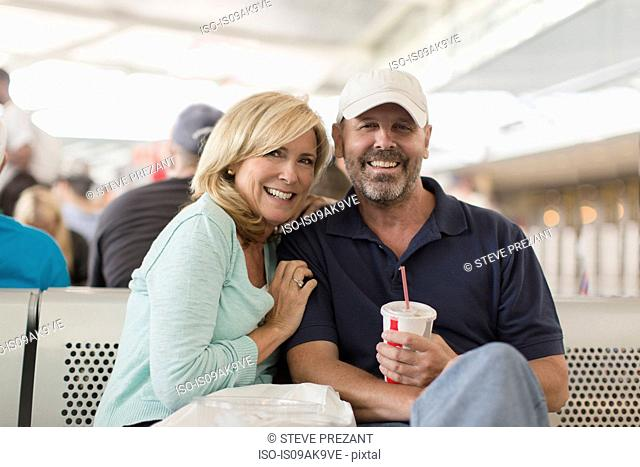 Mature couple on passenger ferry, smiling