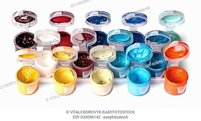 Set of colorful acrylic paints in open jars isolated on white background