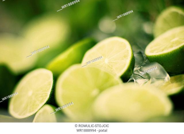 Fresh lime slices and ice cubes, close-up