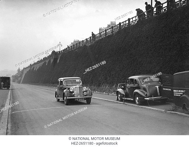 Rover saloon of A Corrie competing in the RAC Rally, Madeira Drive, Brighton, 1939. Artist: Bill Brunell